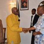 FROM R L- GOV. GODSWILL AKPABIO IN A HANDSHAKE WITH PASTOR AYO ORITSEJAFOR CAN PRESIDENT AND REV. DR. UMA UKPAI DURING A BANQUET IN GOVT. HOUSE, UYO