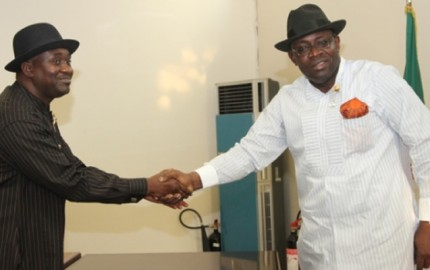 Bayelsa State Governor, Hon. Seriake Dickson (R), congratulating the new Chief Economic Adviser, Mr. Solomon Apreala, shortly after the swearing-in ceremony at the Banquet Hall, Government House.