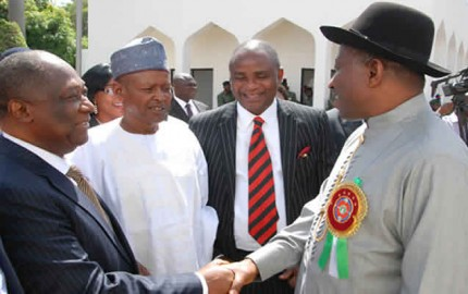 President Goodluck Jonathan (R) Shaking Hands with the Chairman,  NDDC Board, Sen Bassey Ewa-Henshew (L) after the Inauguration of the Board  of in Abuja on Monday (16/12/13). with them are other Board Members.