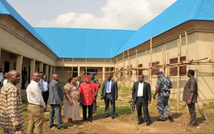 Gov. Theodore Orji of Abia state (middle) on an inspection tour of 20 classroom block at School Road Primary school, Umuahia. With him are some state top fountionaries.