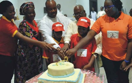 Gov Akpabio with members of his family cutting his 51st Birthday cake in Uyo