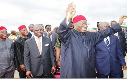 President Goodluck Jonathan accompanied by Delta State Governor, Dr. Emmanuel Uduaghan,  acknowledging cheers from Deltans and PDP faithfuls who came out en-mass to receive him at the Asaba International Airport for the Groundbreaking of the 2nd Niger Bridge Ceremony in Onitsha, Anambra State, Monday.