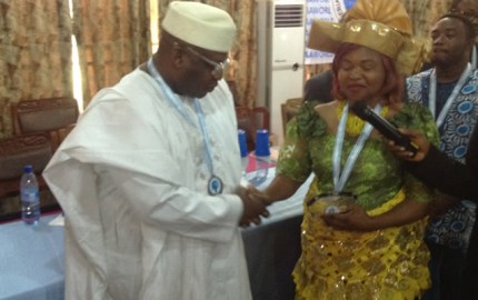 Chairman of the Edo State Chapter of the Peoples Democratic Party (PDP), Chief Dan Orbih, receiving the All Time Astute Politician Award from Prof (Mrs) M. A. Ayinwe during 2014 World Book Day organized by the Nigeria Academicians' and Authors Association at the Banquet Hall, University of Benin, on Saturday.