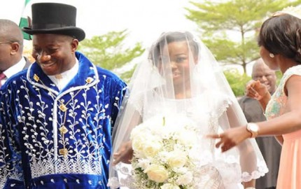 PRESIDENT GOODLUCK JONATHAN WALKING INTO THE CHURCH WITH HIS DAUGHTER, FAITH  DURING THE WEDDING CEREMONY OF DAUGHTER OF THE PRESIDENT, FAITH AND GODSWILL  ABUJA ON  SATURDAY (12/4/14)