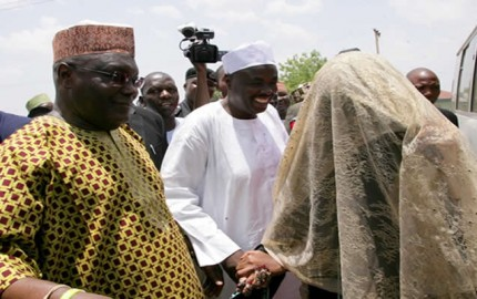 Former Vice President and chieftain of All Progressives Congress (APC) Atiku Abubakar presenting a gift to father of the bride, Mr Nadi Saleeby at the wedding ceremony of his son, Abba in Jada, Jada Local Government Area of Adamawa State over the weekend.