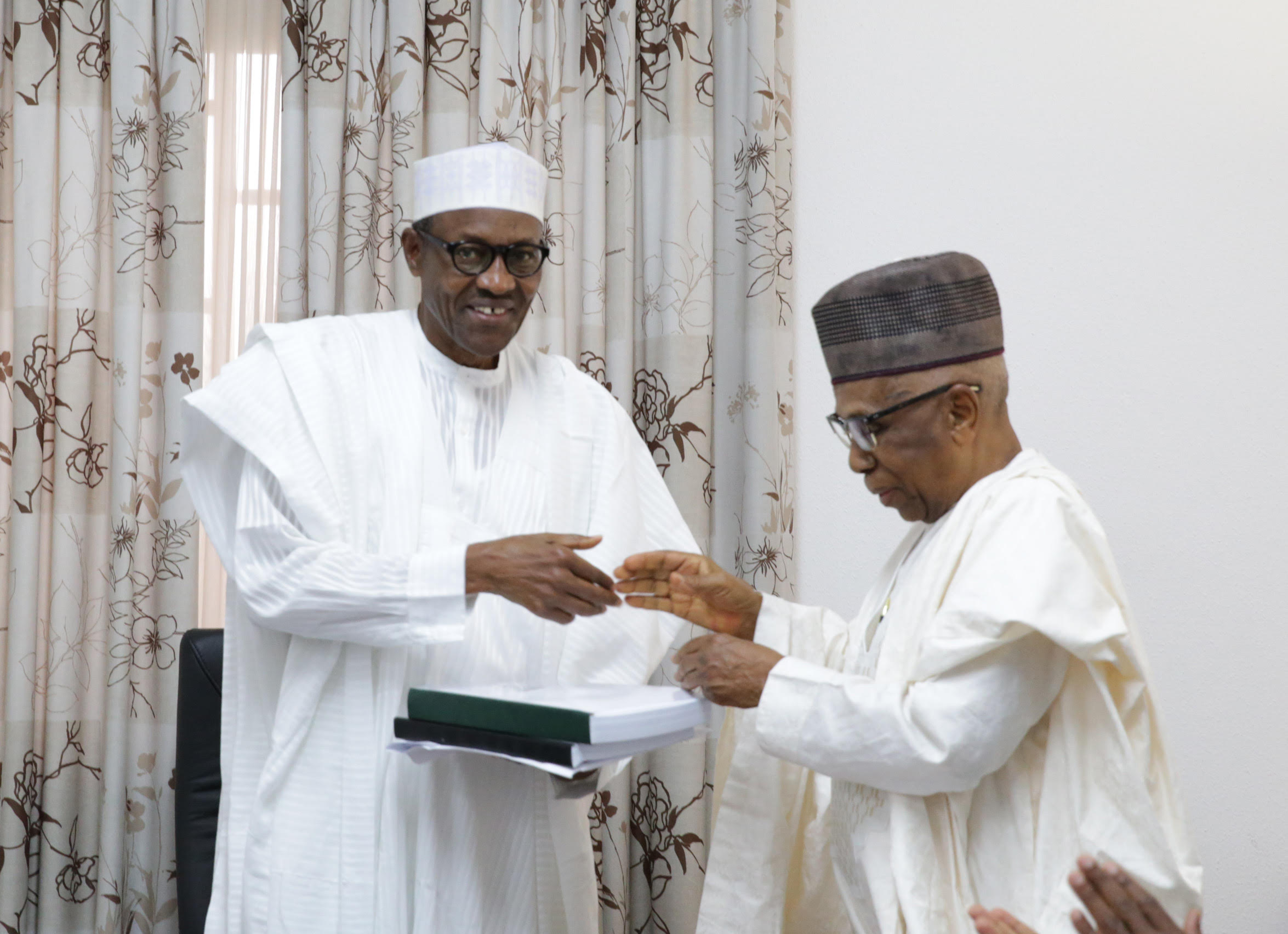 L-R; ,Vice President Prof Yemi Osinbajo, President Muhammadu Buhari AND Chairman Transition Committee, Dr Ahmed Joda as he presents the final report of Transition committee to the President at the defence house in Abuja, PHOTO; JUNE 12 2015