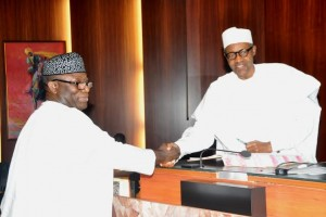 resident Mohammadu Buhari Congratulating Minister of Solid Minerals, Dr Kayode Fayemi, during the inauguration of new ministers at the Presidential Villa...on Wednesday.