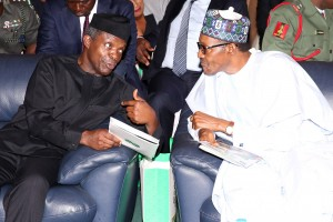 PRESIDENT BUHARI ATTENDS 8TH BOLA TINUBU COLLOQUIUM 4.President Muhammadu Buhari confers with the Vice President Prof Yemi Osinbajo at the8th Senator Bola Ahmed Tinubu Annual Colloguium at the International Conference Centre in Abuja. PHOTOL; SUNDAY AGHAEZE/STATE HOUSE. MARCH 29 2016