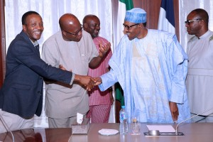 PRESIDENT BUHARI RECEIVES NUPENG n PENGASSAN. 4. R-L;  Minister of State petroleum, Dr Emmanuel Ibe Kachikwu, President Muhammadu Buhari, President of NUPENG, Comrade Igwe Achese, President PENGASSAN, Comrade Olabode Johnson, National Industrial Relations Officer, Ndukaku Ohaeri during a meeting with Mr President at the State House in Abuja. PHOTO; SUNDAY AGHAEZE. MARCH 23 2016.