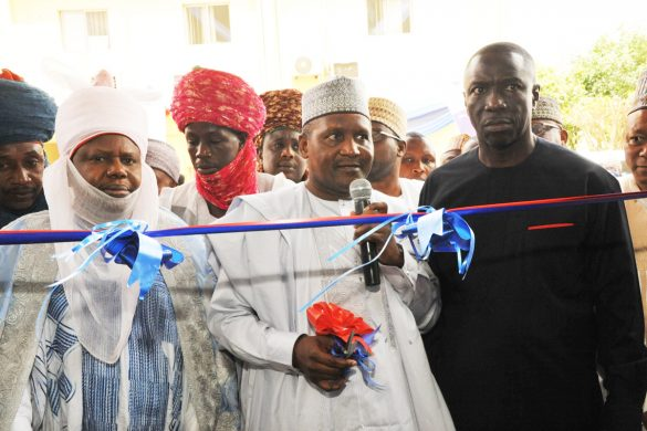 L-R, Dan Majen Kano, District Head of Gwale Alh. Yahya Inuwa Abbas, Representative of Emir of Kano, President \ Chief Executive Dangote Group, Aliko Dangote,Cutting of the Reborn, Chiarman Dangote Flour Mills PLC , Ighodalo Asue,at the Official RE-OPENING of Dangote Flour Mills PLC, Kano Mill.