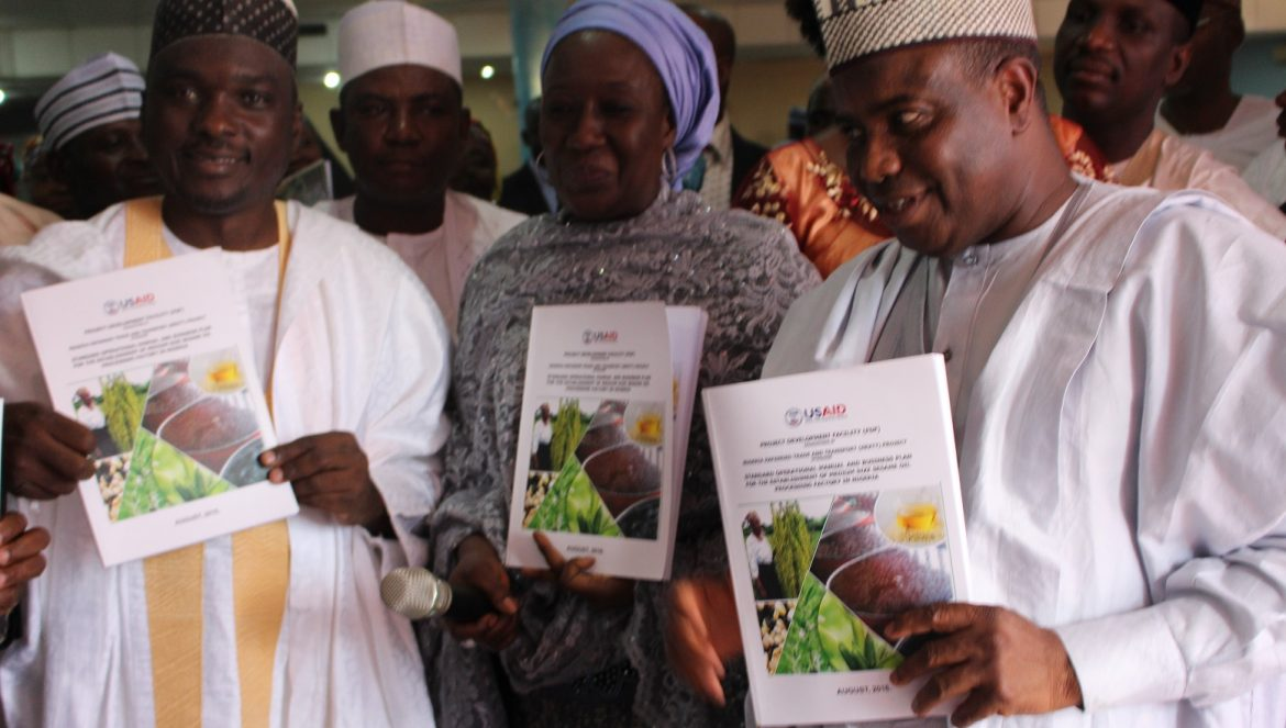 L-R: Chairman of Sesame Growers Association of Nigeria, Mr. Sheriff Balogun Minister of State for Industry, Trade and Investment, Hajiya Aisha Abubakar and Sokoto Governor, Aminu Waziri Tambuwal, unveiling the Sesame Seed Manual/Business Plan during the launching of Federal Government's initiative to boost sesame production in Nigeria, which held in Sokoto...Wednesday 17/08/16