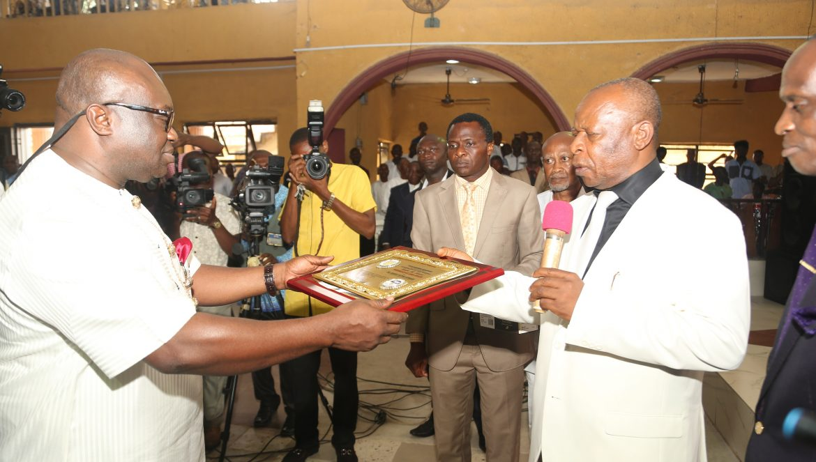 *Abia state Governor, Dr. Okezie Ikpeazu (left) receiving an award as ''NEHEMIAH OF ABIA'' by the Men's Ministry Aba North District of Assemblies of God Church, from Rev. P.C.Emeaba, District Superintendent at Assemblies of God Church, Ukegbu Road in Aba.*