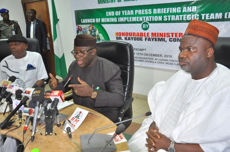 L-R: Chair, Senate Committee on Solid Minerals, Senator James Manager, Minister of Mines and Steel Development, Dr Kayode Fayemi and Minister of State for Mines and Steel Development, Hon Abubakar Bawa Bwari, during the 2016 end of year ministerial briefing and launch of the Mining Implementation Strategy Team (MIST), in Abuja ...on Monday.