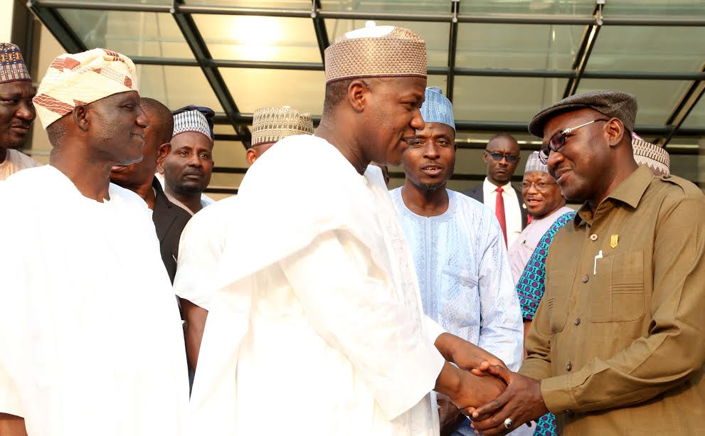 Speaker , House of Representatives, Rt. Hon. Yakubu Dogara (right) in a handshake with President, Nigerian  Union of Local Government  Employees ( NULGE) ,Comrade Ibrahim Khaleel while Deputy Speaker, Hon. Yussuf Lasun looks on  during a Solidarity visit to the Speaker by the National Leadership of NULGE  at the National Assembly on 18th Jan. 2017