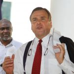 US-Ambassador-to-Nigeria-W-Stuart-Symington-presents-remarks-at-the-World-AIDS-Day-2016-event-while-Dr-Isa-Iyortim-looks-on-e1481641525776