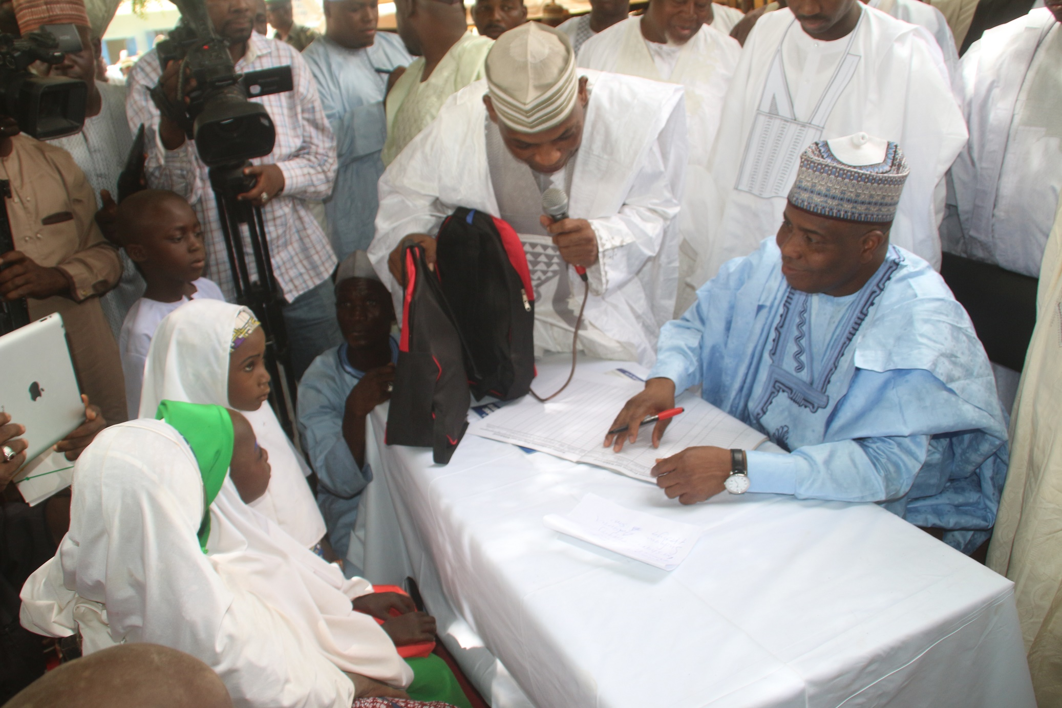 Enrollment 3: Governor Aminu Waziri Tambuwal enrolling new intakes into primary school at the flag-off of Sokoto state school enrollment drive in Riji, Rabah LGA.